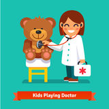 Small girl playing a doctor with teddy bear toy. Small girl playing a doctor with plush teddy bear toy. Kid examining patient. Flat style illustration isolated Royalty Free Stock Image