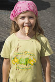 Small girl playing with ice-cream royalty free stock images