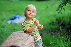 Small girl playing outdoor Stock Photo