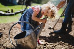 Free Small Girl Playing Outdoors In Garden, Sustainable Lifestyle Concept. Royalty Free Stock Photo - 194402975