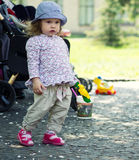Small girl, playing in the park Stock Photos