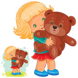 Small girl playing with Teddy bear Royalty Free Stock Photo