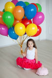 Small girl plays with colorful balloons Royalty Free Stock Photography