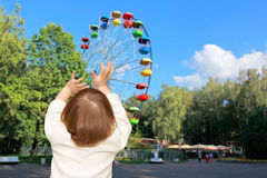 The small girl and Ferris wheel Royalty Free Stock Photography