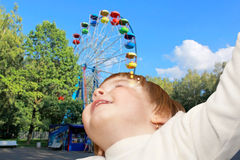 The small girl and Ferris wheel Stock Photo