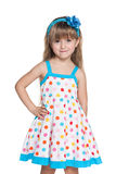 Small girl in polka dot dress Stock Photo