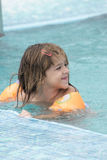 Small girl in the pool Stock Photos
