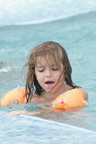 Small girl in the pool Stock Photography