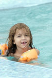 Small girl in the pool Royalty Free Stock Photo