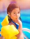 Small girl in poolside Royalty Free Stock Photo
