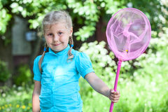 Small girl portrait with butterfly net Royalty Free Stock Photos
