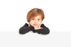 A small girl posing on a blank panel Stock Photos