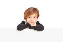 A small girl posing on a blank panel Stock Photos
