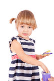 Small girl with purple paint on her palms Royalty Free Stock Photo