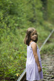Small girl on the rail tracks Stock Photography