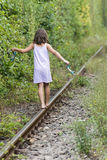Small girl on the rail tracks Royalty Free Stock Image