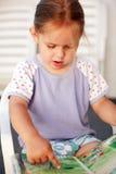 Small girl reading Stock Photo
