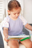 Small girl reading Royalty Free Stock Photo