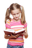 Small girl reading a book. Small funny girl reading a book on white background Stock Photos