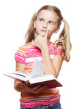 Small girl reading a book. Small funny girl reading a book on white background Stock Photography
