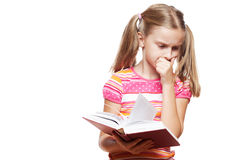 Small girl reading a book. Small funny girl reading a book on white background Royalty Free Stock Image