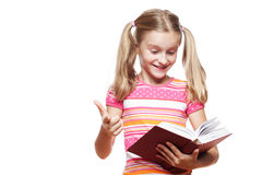 Small girl reading a book. Stock Photos