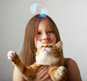 Small girl with a red cat Royalty Free Stock Photos