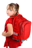 Small girl with red school bag isolated on white. Portrait of pre-teen blonde school girl in red clothes, with her red school bookbag, looking back over her Stock Image
