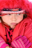 Small girl in red winter clothes isolated on white Royalty Free Stock Image