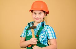 Small girl repairing with hammer in workshop. Child care development. Future profession. Builder engineer architect. Kid. Worker in hard hat. Tools to improve stock image