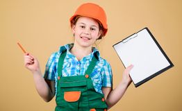 Small girl repairing in workshop. Foreman inspector. Repair. Builder engineer architect. Kid worker in hard hat. Child stock images
