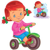 Small girl riding a tricycle Royalty Free Stock Image