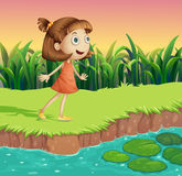 A small girl at the riverbank Stock Photos