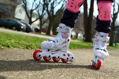 Small girl roller skating outdoor Royalty Free Stock Photo