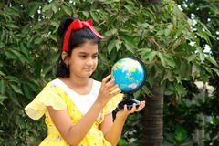 Small girl rotating the globe Stock Images