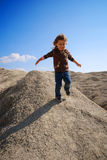 Small girl running down hill Royalty Free Stock Photos