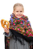 Small girl in Russian kerchief with pretzel Stock Photos