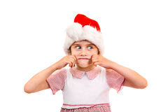 Small Girl in Santa Hat Stock Images