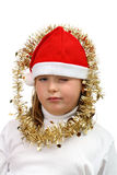 Small girl in Santa's red hat with golden chains Stock Photography