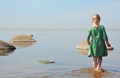 Small girl at the sea shore Royalty Free Stock Photo