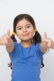 Small girl showing two thumbs up. Stock Photography