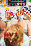 Small girl shows painted colorful hands Stock Photo