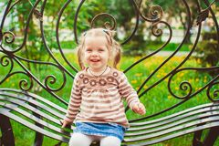 Girl sitting on the bench Royalty Free Stock Photos