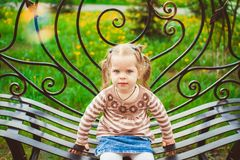 Girl sitting on the bench Royalty Free Stock Image