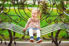 Girl sitting on the bench Stock Image