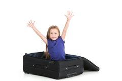 Small girl sitting in black suitcase. Royalty Free Stock Photography