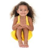 Small girl sitting on the floor Stock Photo