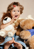 Small girl sitting with toys Stock Image
