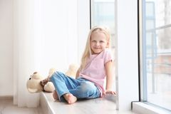 Small girl sitting royalty free stock photo