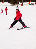 Small girl skiing Stock Image